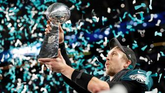 NFL Football - Philadelphia Eagles v New England Patriots - Super Bowl LII - U.S. Bank Stadium, Minneapolis, Minnesota, U.S. - February 4, 2018  Philadelphia Eagles' Nick Foles celebrates with the Vince Lombardi Trophy after winning Super Bowl LII  REUTERS/Kevin Lamarque     TPX IMAGES OF THE DAY