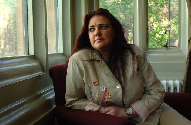 Carol Grayson gave up work to care for her husband, who contracted HIV from infected