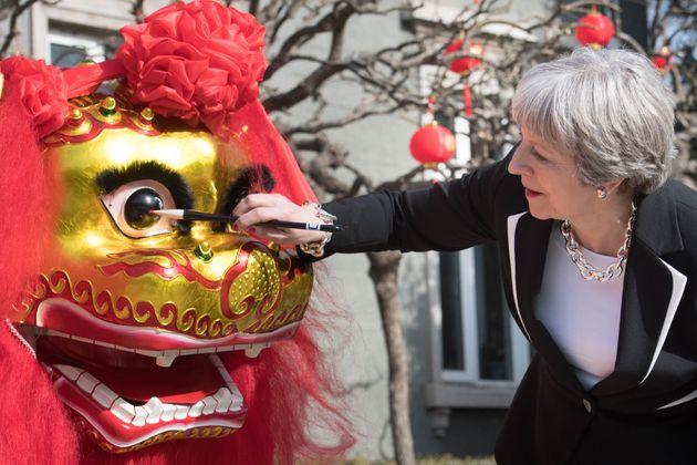 The Brexit row followed Theresa May to China last