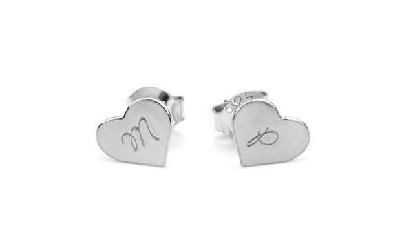 """Get them <a href=""""https://www.groupon.com/deals/n-jewells-house-engraved-heart-studs"""" target=""""_blank"""">here</a>."""