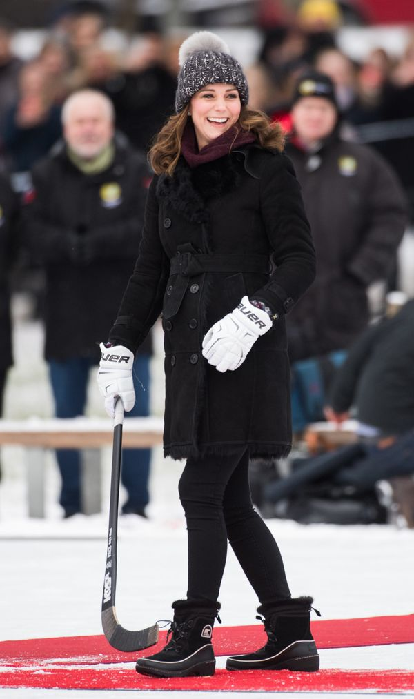 Kate reacts after hitting the ball as she attends a Bandy hockey match with William in Sweden.