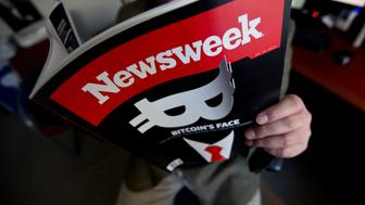 This photo illustration shows a man reading a copy of the new print edition of Newsweek magazine in Washington on March 10, 2014. Newsweek, online only since the end of 2012, returned to print on March 7 in the United States and Europe. Parent company IBT Media is taking a gamble in re-launching the once-iconic news weekly, which has nearly disappeared in the face of serious financial difficulties. In crafting its print resurrection, the New York-based online media group, led by French businessman Etienne Uzac, has adopted a strategy that goes against current practices. The new magazine will seek to position itself as a high-end product, in particular with higher quality paper and printing than its competitors.    AFP PHOTO/Nicholas KAMM        (Photo credit should read NICHOLAS KAMM/AFP/Getty Images)