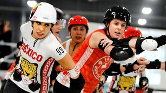 MANCHESTER, ENGLAND - FEBRUARY 04:  Team Mexico and Team Switzerland compete in Roller Derby World Cup at EventCity on February 4, 2018 in Manchester, England.  (Photo by Shirlaine Forrest/Getty Images)