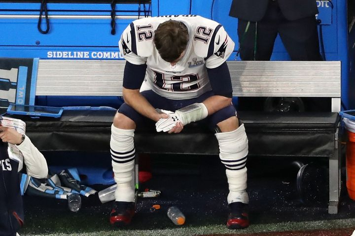 Patriots Quarterback Tom Brady sits on the bench after having the ball stripped by Brandon Graham of the Philadelphia Eagles.