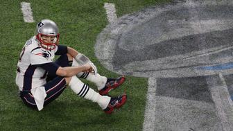 MINNEAPOLIS, MN - FEBRUARY 4: New England Patriots quarterback Tom Brady sits on the field at the end of the 4th quarter of Super Bowl LII.  The New England Patriots play the Philadelphia Eagles in Super Bowl LII at US Bank Stadium in Minneapolis on Feb. 4, 2018. (Photo by Stan Grossfeld/The Boston Globe via Getty Images)
