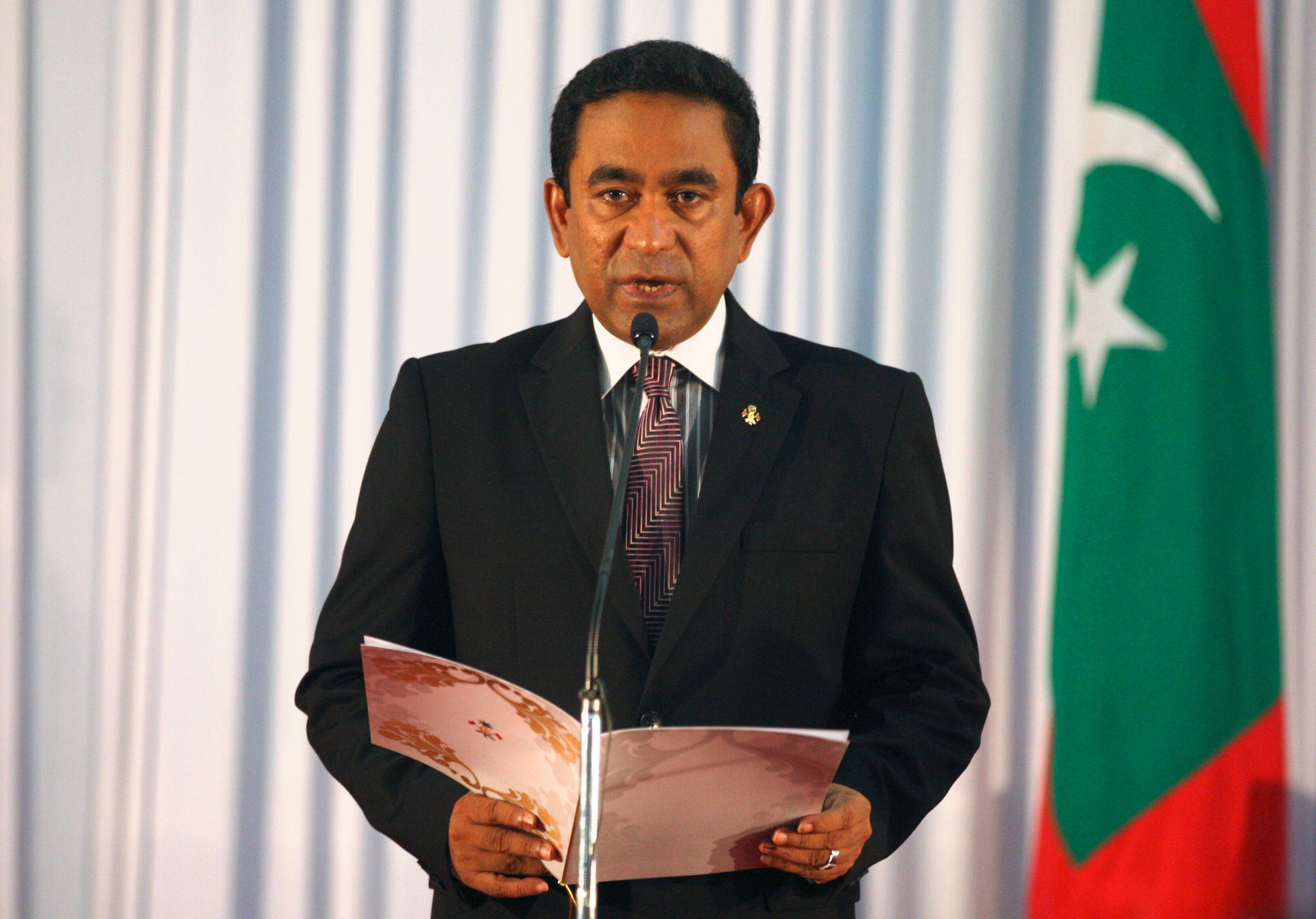 Abdulla Yameen takes his oath as the President of Maldives during a swearing-in ceremony at the parliament in Male November 17, 2013. Yameen won the Maldives presidential election run-off on Saturday, narrowly defeating the favourite Mohamed Nasheed in a ballot that voters hoped would end two years of political turmoil that has hit the vital tourism sector. REUTERS/Waheed Mohamed (SRI LANKA  - Tags: POLITICS ELECTIONS)