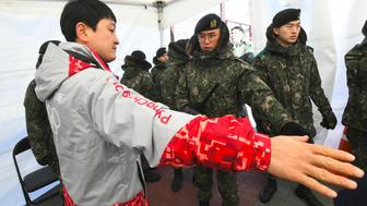 South Korean soldiers inspect a visitor at a security checkpoint as they replace security guards showing symptoms of the norovirus at the Gangneung Ice Arena in Gangneung on February 6, 2018 ahead of the Pyeongchang 2018 Winter Olympic Games. According to officials at Korea Centers for Disease Control and Prevention and the PyeongChang Organizing Committee, three out of 41 guards who suffered from diarrhea and vomiting were diagnosed with having the norovirus on February 5. / AFP PHOTO / JUNG Yeon-Je        (Photo credit should read JUNG YEON-JE/AFP/Getty Images)