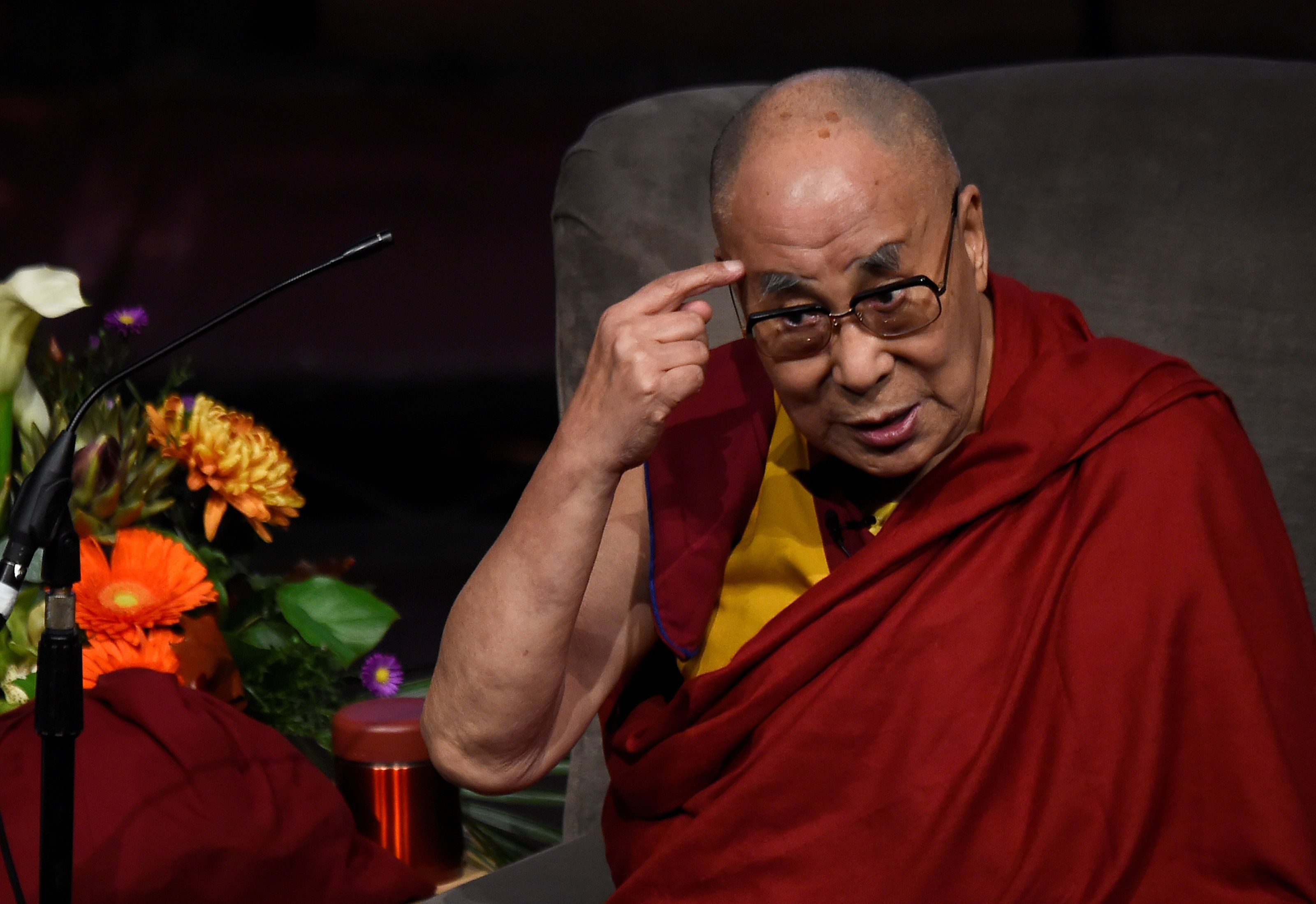Tibetan spiritual leader the Dalai Lama gestures as he speaks at an event in Londonderry, Northern Ireland, September 10, 201