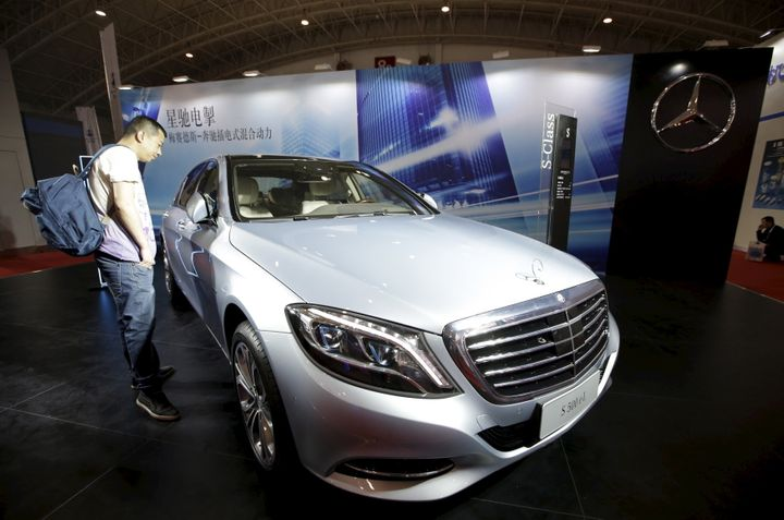 A visitor looks at a Mercedes-Benz car during a car show in Beijing, China, April 25, 2016.