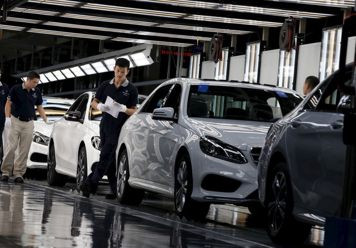 Employees work on an assembly line producing Mercedes-Benz cars at a factory in Beijing, China, August 31, 2015.