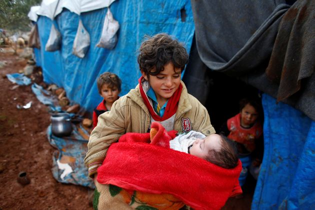 Syrian refugees in the Kelbit refugee camp, near the Syrian-Turkish