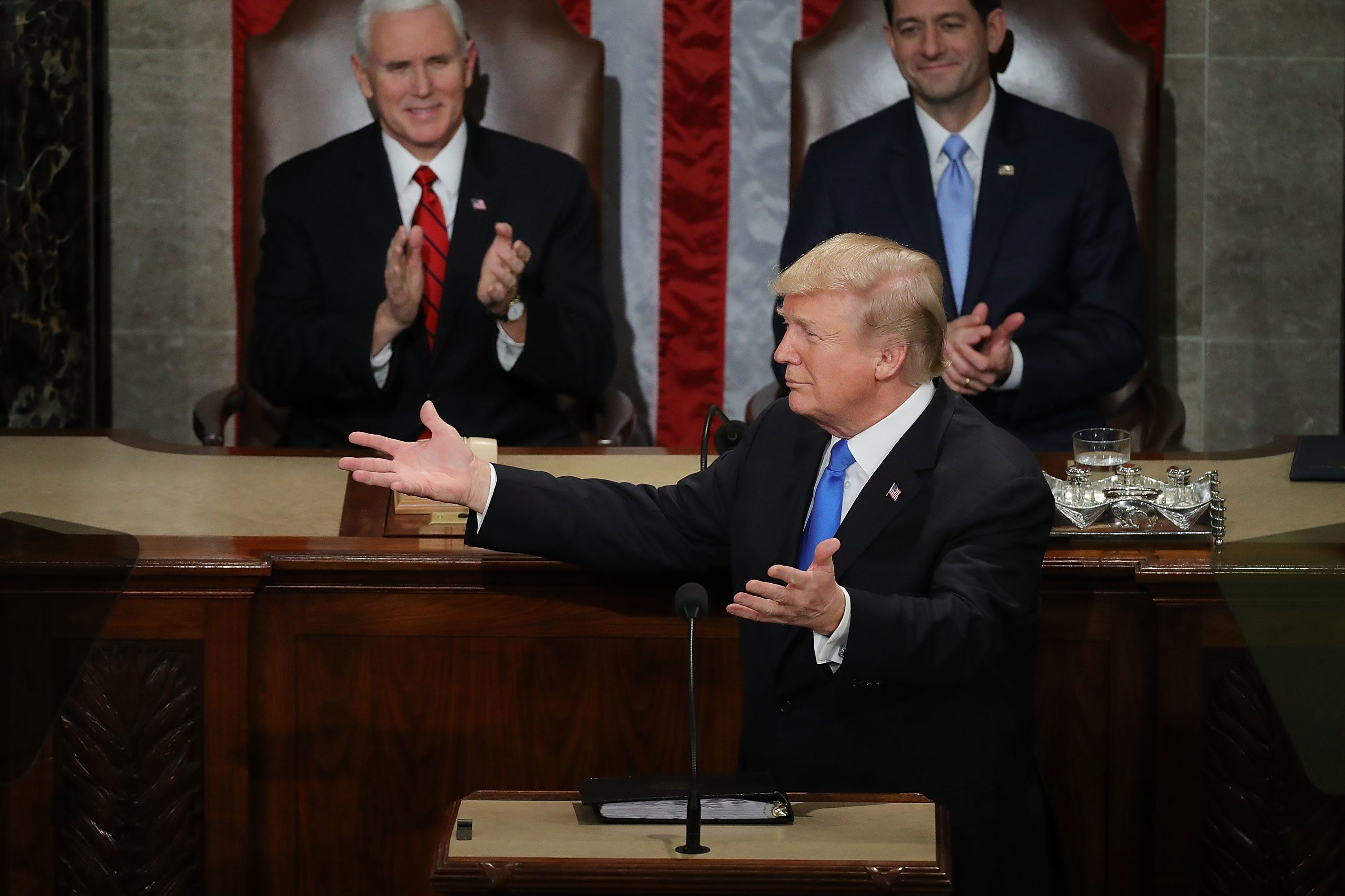 WASHINGTON, DC - JANUARY 30:  U.S. President Donald J. Trump delivers the State of the Union address as U.S. Vice President Mike Pence (L) and Speaker of the House U.S. Rep. Paul Ryan (R-WI) (R) look on in the chamber of the U.S. House of Representatives January 30, 2018 in Washington, DC. This is the first State of the Union address given by U.S. President Donald Trump and his second address to a joint meeting of Congress.  (Photo by Chip Somodevilla/Getty Images)