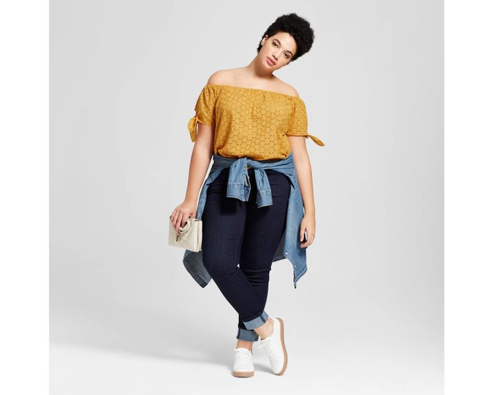 "From Target's new Universal Thread clothing line, featuring the <a href=""https://www.target.com/p/women-s-plus-size-eyelet-off-the-shoulder-top-universal-thread-153-gold/-/A-53055605#lnk=newtab"" target=""_blank"">Eyelet Off the Shoulder Top in gold</a>."