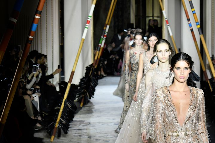 Models walk the runway at the Zuhair Murad couture show in Paris on Jan. 24. Murad was accused of cultural appropriation for this collection, which was promoted with the hashtag #IndianSummer.