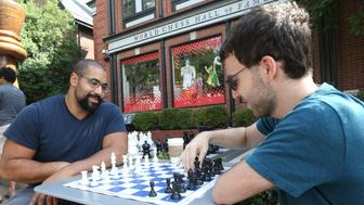 Grandmaster chess player Robert Hess of New York (R) teaches former Baltimore Ravens offensive lineman John Urschel several moves at the Chess Club and Scholastic Center in St. Louis on August 13, 2017.  Several Grandmasters are in St. Louis to compete in the Grand Chess Tour including Garry Kasparov. / AFP PHOTO / BILL GREENBLATT        (Photo credit should read BILL GREENBLATT/AFP/Getty Images)