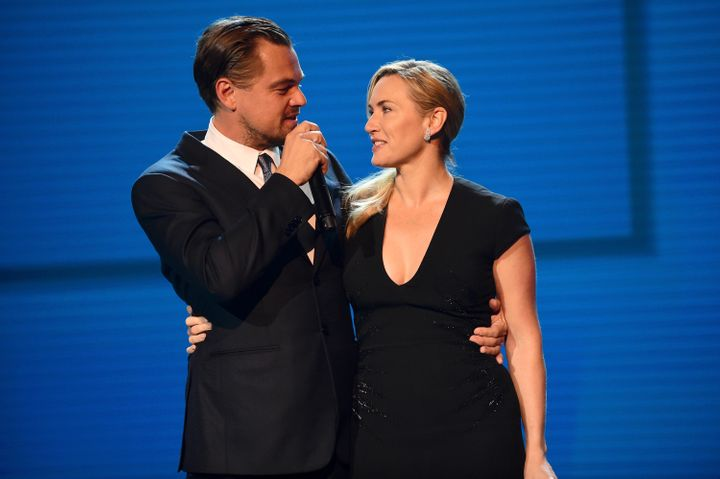 DiCaprio and Winslet stand together onstage at the Leonardo DiCaprio Foundation Gala in St. Tropez, France, in July 2017.