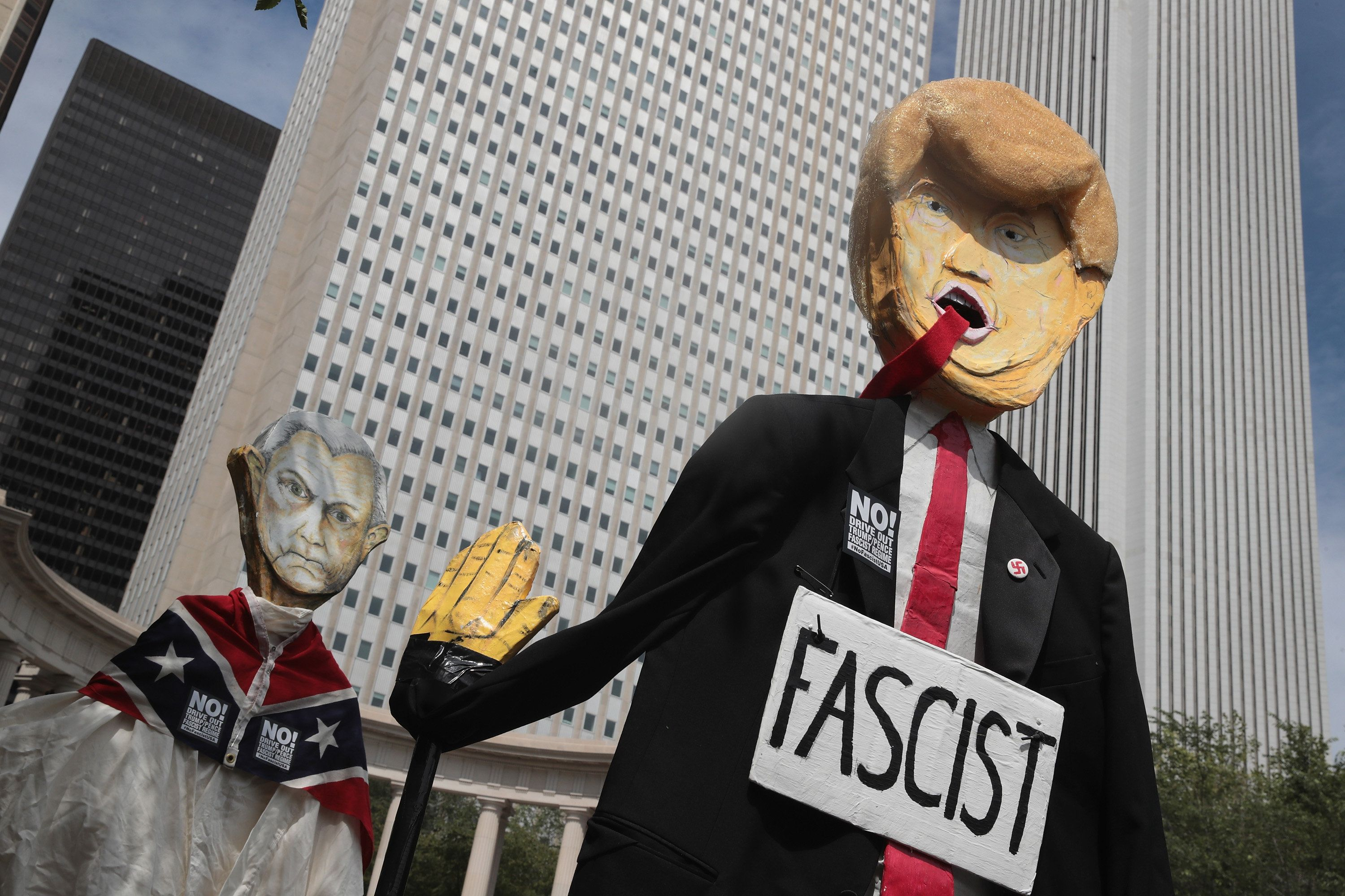 CHICAGO, IL - AUGUST 13:  Demonstrators protesting the alt-right movement and mourning the victims of yesterdays rally in Charlottesville, Virginia carry puppets of President Donald Trump and  U.S. Attorney General Jeff Sessionson August 13, 2017 in Chicago, Illinois. One person was killed and 19 others were injured in Charlottesville when a car plowed into a group of activists who were preparing to march in opposition to a nearby white nationalists rally. Two police officers were also killed when a helicopter they were using to monitor the rally crashed.  (Photo by Scott Olson/Getty Images)