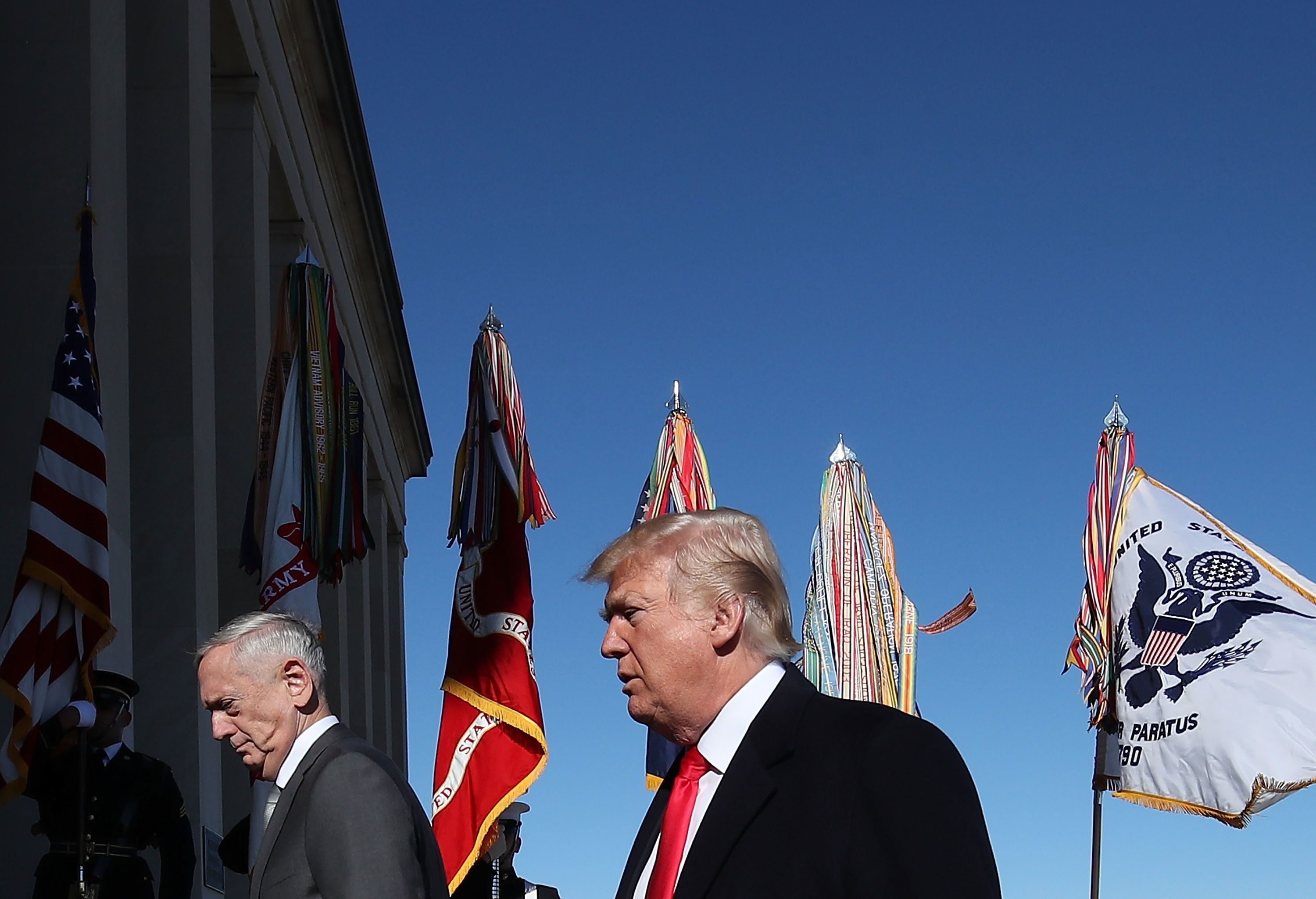 ARLINGTON, VA - JANUARY 18:  U.S. President Donald Trump and Defense Secretary Jim Mattis (L) walk into the Pentagon for a meeting with military leaders on January 18, 2018 in Arlington, Virginia.  (Photo by Mark Wilson/Getty Images)