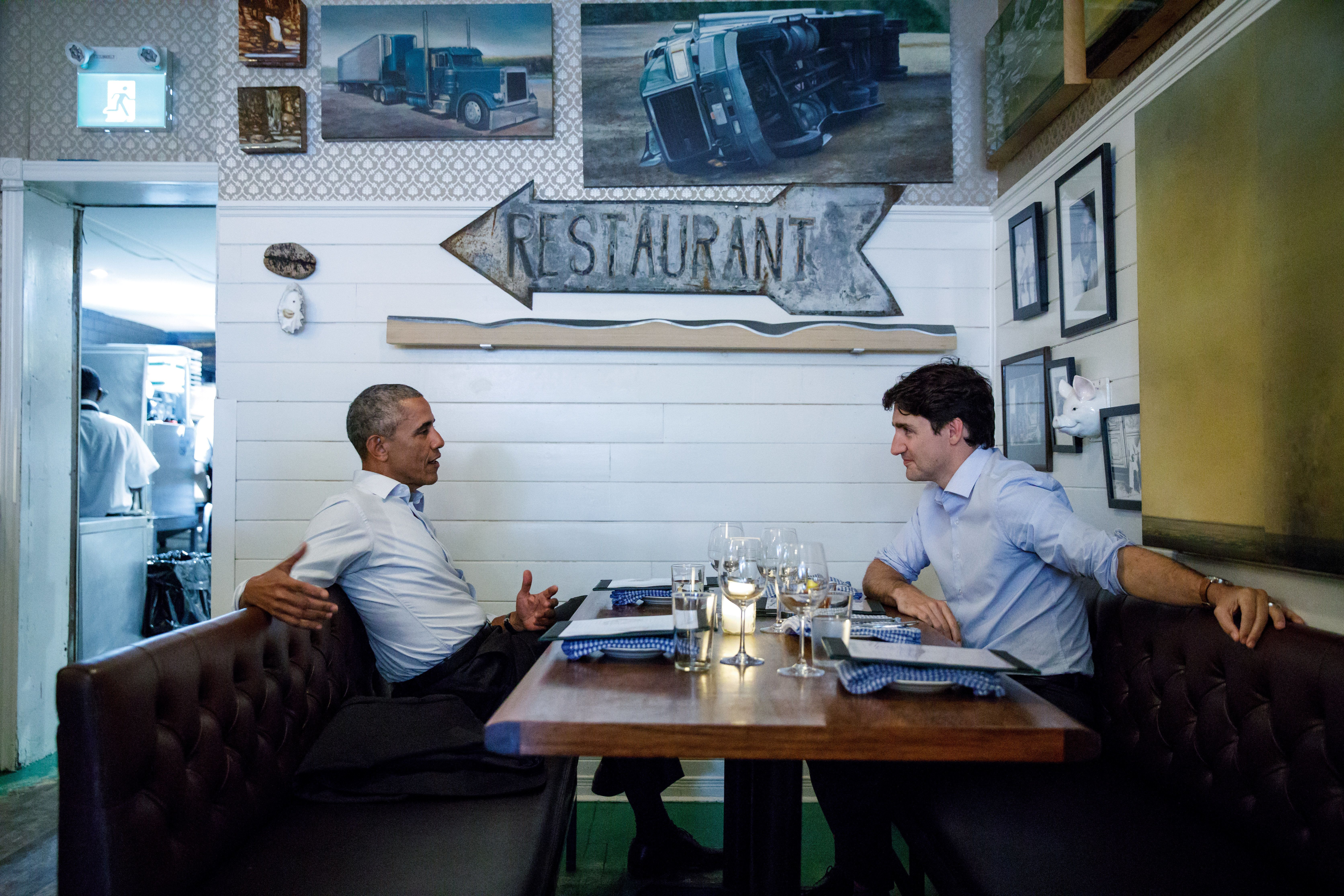 Canada's Prime Minister Justin Trudeau speaks during dinner with former United States President Barack Obama at Liverpool House restaurant during Obama's visit to address the Montreal Chamber of Commerce, in Montreal, Quebec, Canada June 6, 2017. Picture taken June 6, 2017. Adam Scotti/Prime Minister's Office/Handout via REUTERS   ATTENTION EDITORS - THIS IMAGE WAS PROVIDED BY A THIRD PARTY. EDITORIAL USE ONLY.