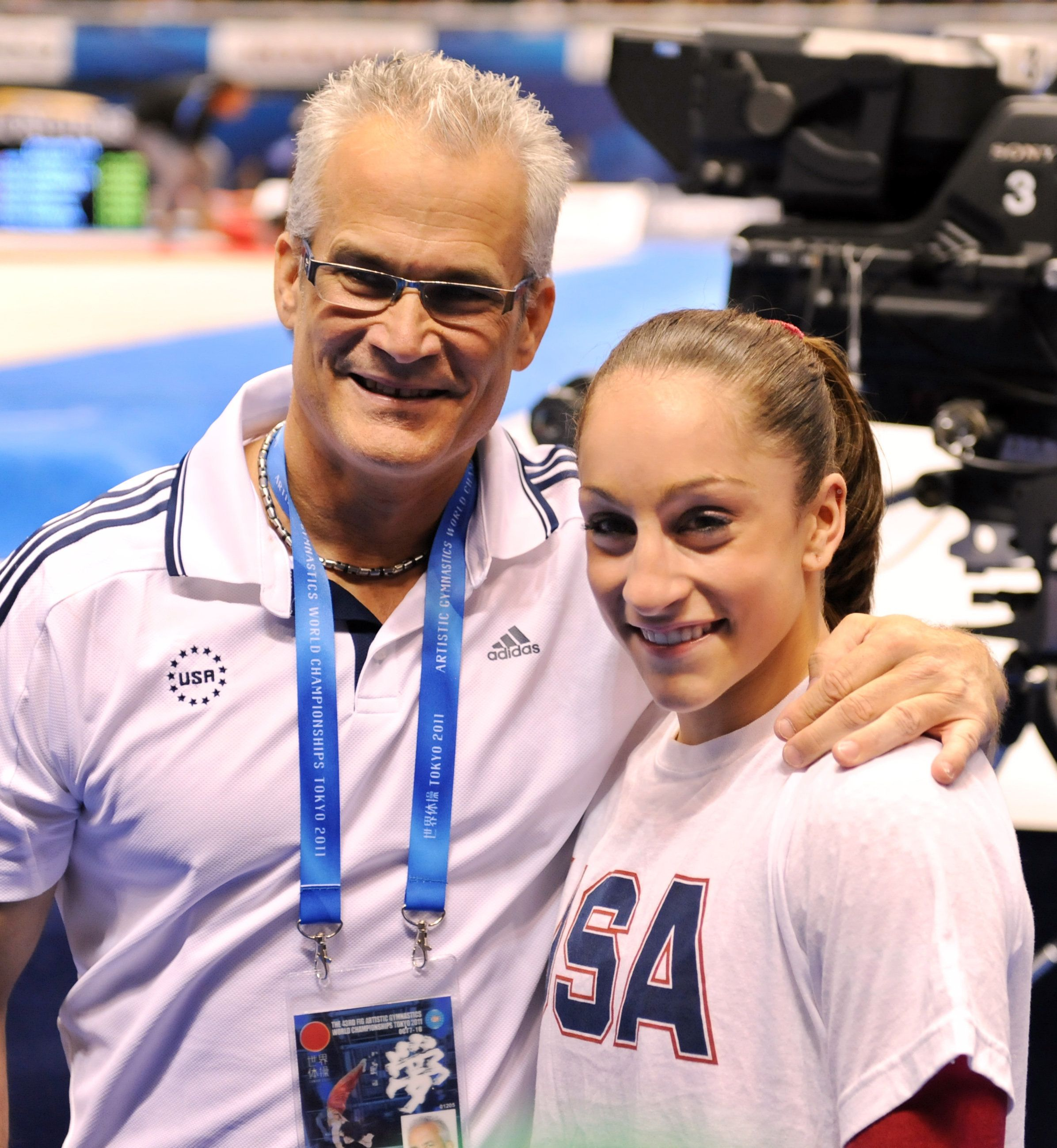 Jordyn Wieber of the US (R) celebrates her victory with her coach John Geddert in the women's all-around final at the World Gymnastics Championships in Tokyo on October 13, 2011.  Wieber won the women's all-around title at the world gymnastics championships with a dramatic comeback in the final event.    AFP PHOTO/KAZUHIRO NOGI (Photo credit should read KAZUHIRO NOGI/AFP/Getty Images)