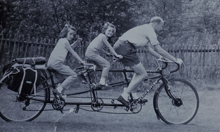 Jack and his daughters cycling in the sixties.