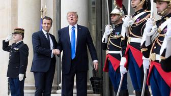 FILE: Emmanuel Macron, France's president, center left, and U.S. President Donald Trump, center right, shake hands while posing for photographs at the Elysee Palace in Paris, France, on Thursday, July 13, 2017. The one year anniversary of U.S. President Donald Trump's inauguration falls on Saturday, January 20, 2018. Our editors select the best archive images looking back over Trumps first year in office. Photographer: Christophe Morin/Bloomberg via Getty Images
