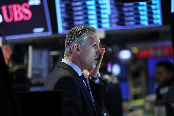 Traders work on the floor of the New York Stock Exchangeon Feb. 6 during a wild day of market swings.