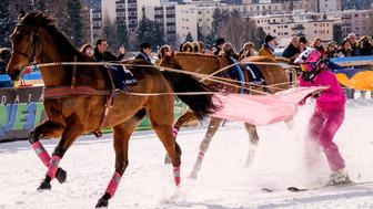 ST MORITZ, SWITZERLAND - FEBRUARY 12:  Jockeys and horses take part in the skijoring race on February 12, 2017 in St Moritz, Switzerland.  'White Turf' is a series of horse races on the frozen lake of St. Moritz that takes place on the 12th, 19th, 26th of February this year.  (Photo by Awakening/Getty Images)