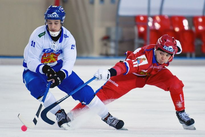 Finnish and Russian hockey players compete inthe 2018 Bandy World Championship semi-final match in Khabarovsk, Russia.