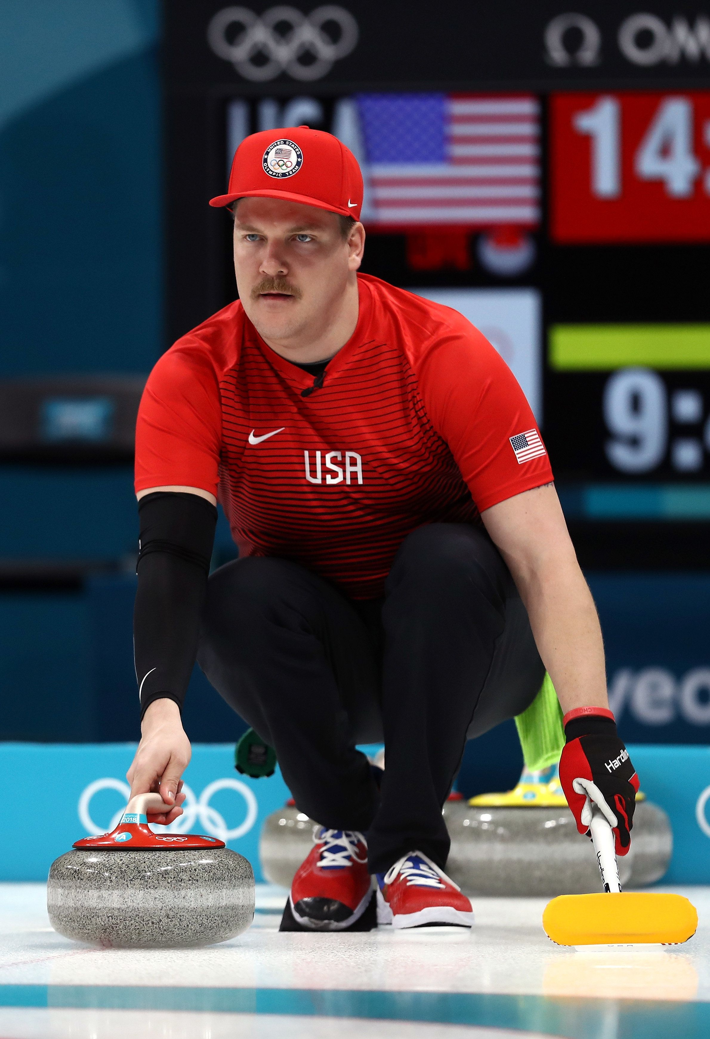 PYEONGCHANG-GUN, SOUTH KOREA - FEBRUARY 08:  Matt Hamilton of the United States delivers a stone against Olympic Athletes from Russia in the Curling Mixed Doubles Round Robin Session 1 during the PyeongChang 2018 Winter Olympic Games at Gangneung Curling Centre on February 8, 2018 in Pyeongchang-gun, South Korea.  (Photo by Ronald Martinez/Getty Images)