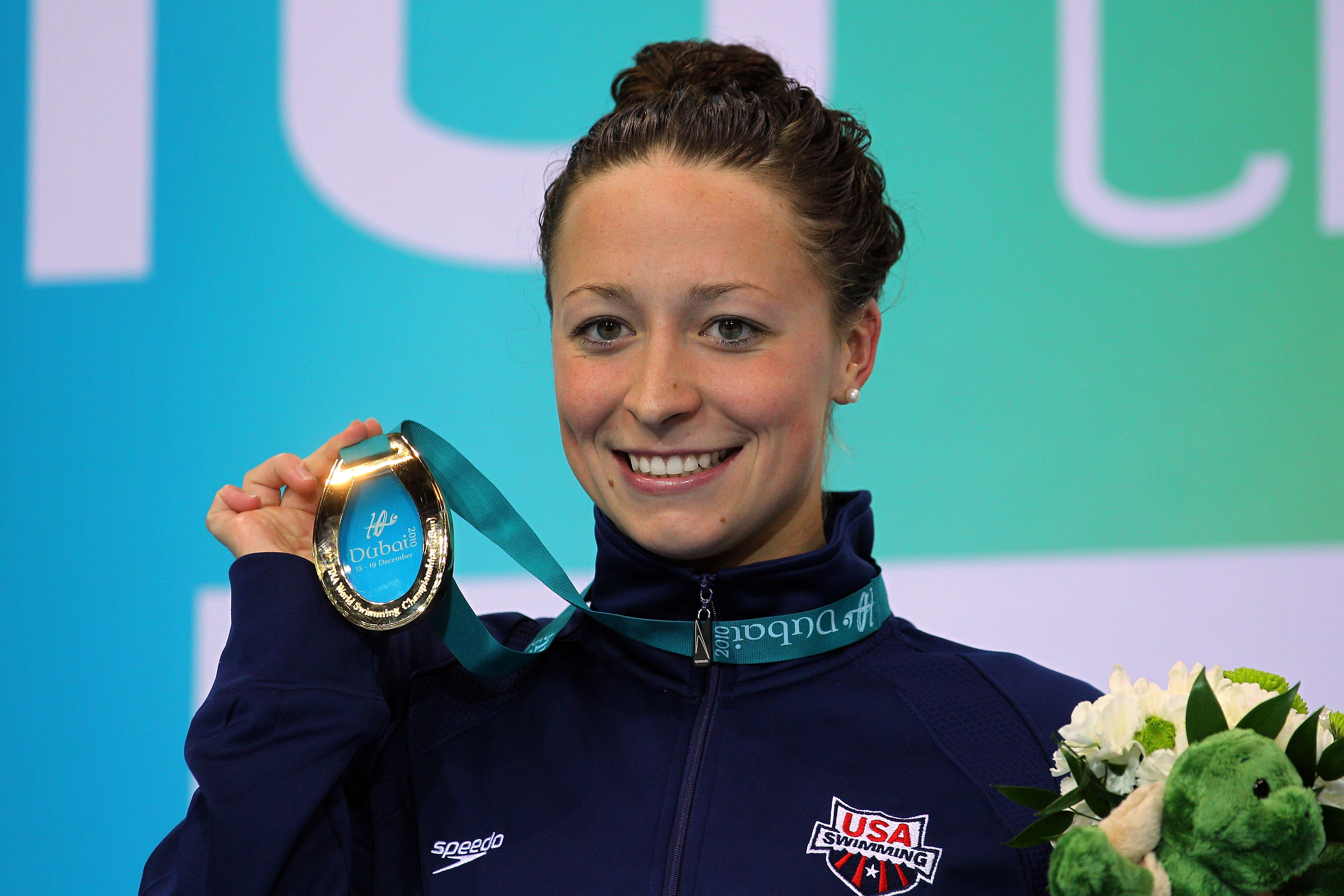 DUBAI, UNITED ARAB EMIRATES - DECEMBER 17: Ariana Kukors of USA poses with her Gold medal after winning the Women's 100m Individual Medley final on day three of the 10th FINA World Swimming Championships (25m) at the Hamdan bin Mohammed bin Rashid Sports Complex on December 17, 2010 in Dubai, United Arab Emirates.  (Photo by Clive Rose/Getty Images)
