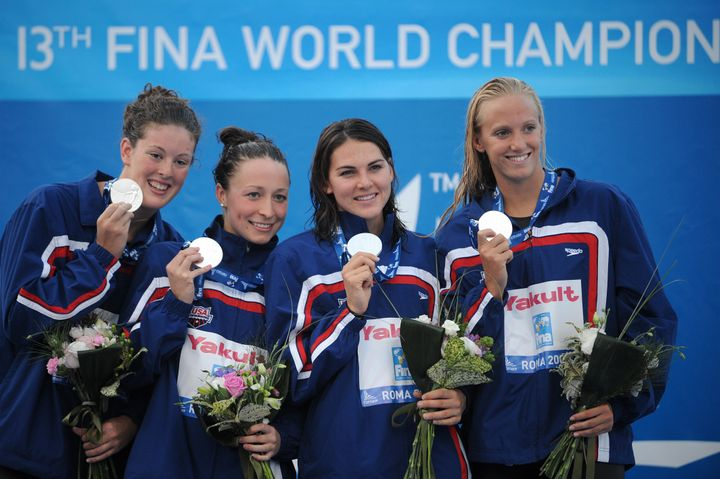Kukors celebrating with teammates Dana Vollmer, Lacey Nymeyer and Allison Schmitt after winning their silver medal