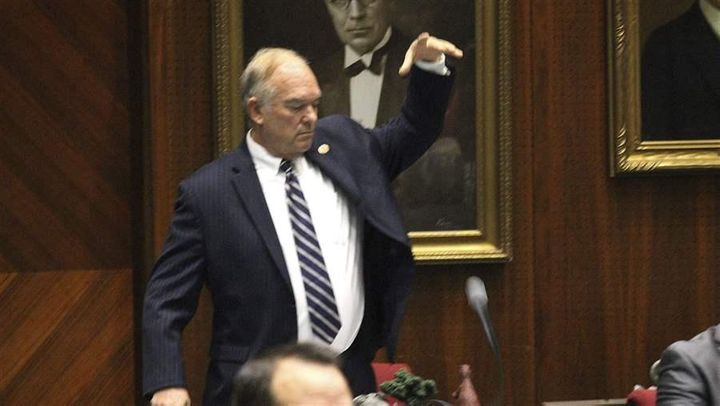 Arizona state Rep. Don Shooter, a Republican, drops his mic after voting no on a resolution that expelled him from the Legisl