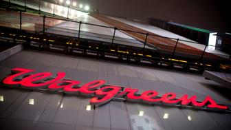 The logo of Walgreens is seen at their Times Square store in New York December 17, 2012. REUTERS/Andrew Kelly/File Photo  GLOBAL BUSINESS WEEK AHEAD PACKAGE Ð SEARCH ÒBUSINESS WEEK AHEAD JULY 4Ó FOR ALL IMAGES