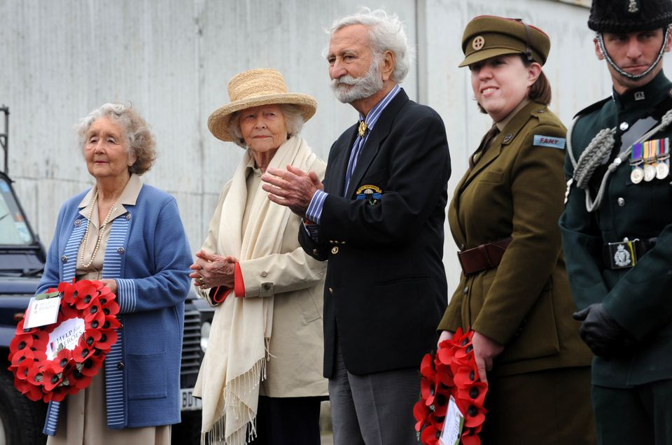 Members of the SOE and a WWII French Resistance veteran greet the Band of Brothers bike ride cyclist...