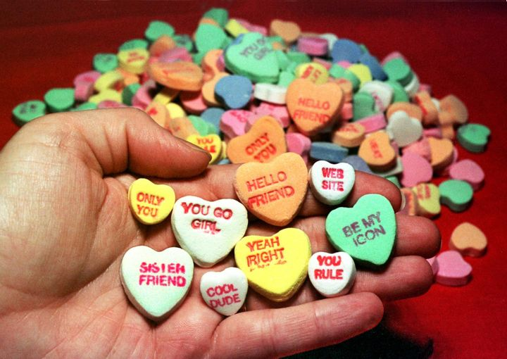 "Necco candy hearts from 1998 with phrases like ""YOU GO GIRL"" and ""WEB SITE."""