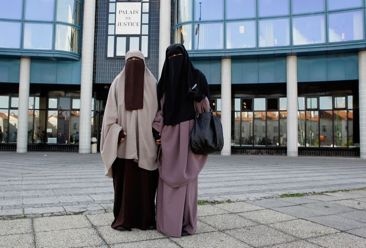 Hind Ahmas (right) stands with Kenza Drider as she leaves a court in Meaux, France, after facing fines for wearing