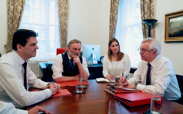 Brexit Secretary David Davis with Permanent Representative of the UK to the EU, Sir Tim Barrow, and lead...