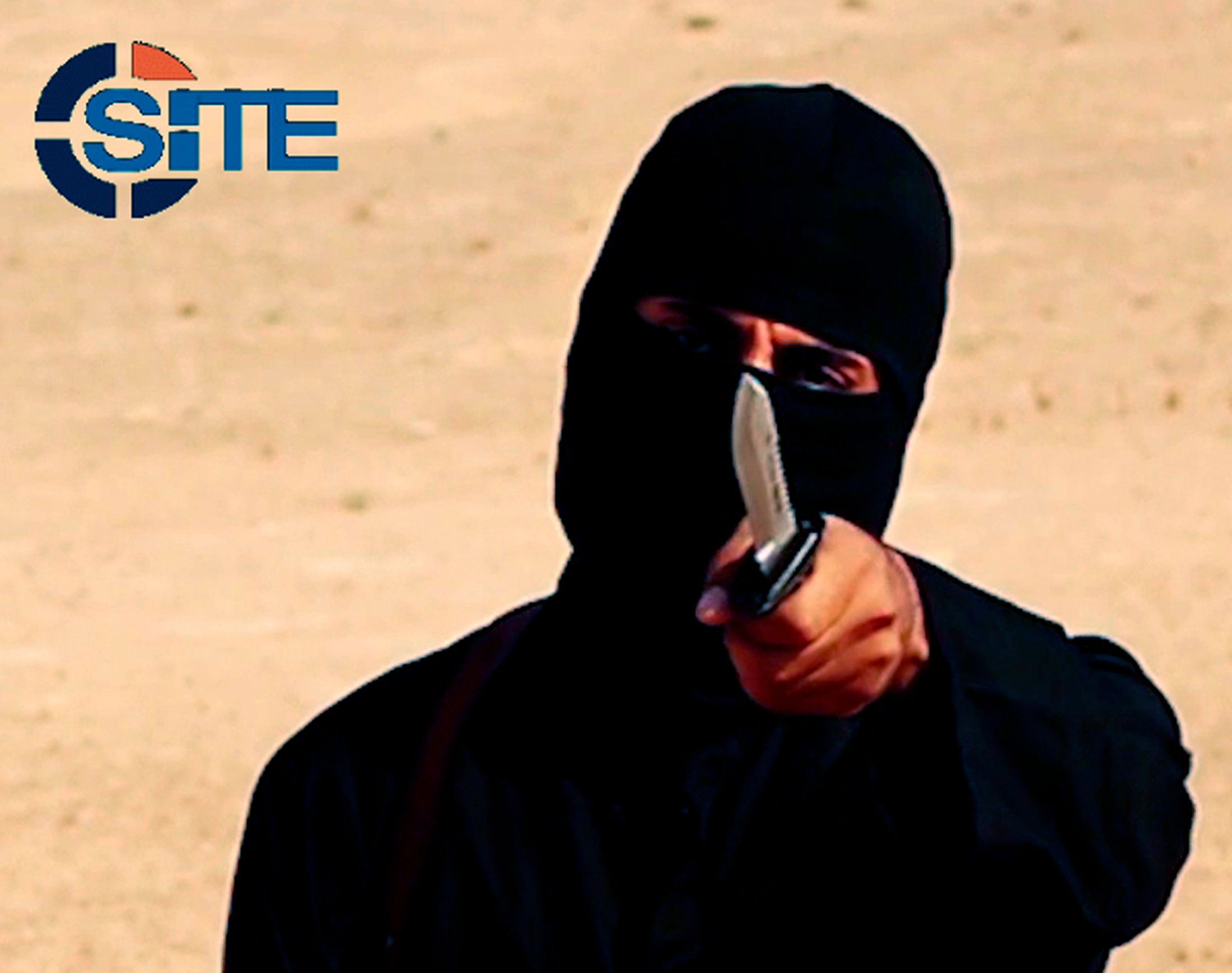 "A masked, black-clad militant, identified asMohammed Emwazi (""Jihadi John""), is pictured in 2014. Members of his terror"