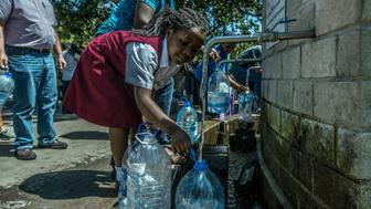 CAPE TOWN, SOUTH AFRICA - JANUARY 30:   (EDITORS NOTE: Image was created as a still grab taken from video.)  Cape Town residents queue to refill water bottles at Newlands Brewery Spring Water Point on January 30, 2018 in Cape Town, South Africa. Diminishing water supplies may lead to the taps being turned off for the four millions inhabitants of Cape Town on April 16 2018, known locally as Day Zero. Water will be restricted from 87 litres per day to 50 litres as temperatures reach 28 degrees later this week.  Politicians are blaming each other and residents for the deepening crisis. (Photo by Morgana Wingard/Getty Images)