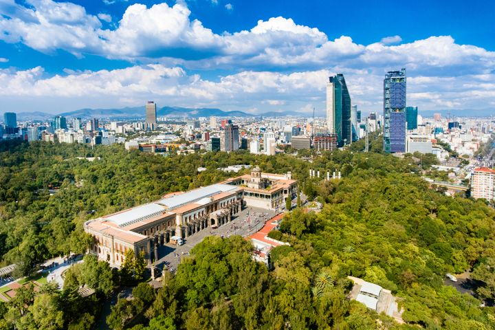 Chapultepec Castle with Mexico City's skyline in the background.