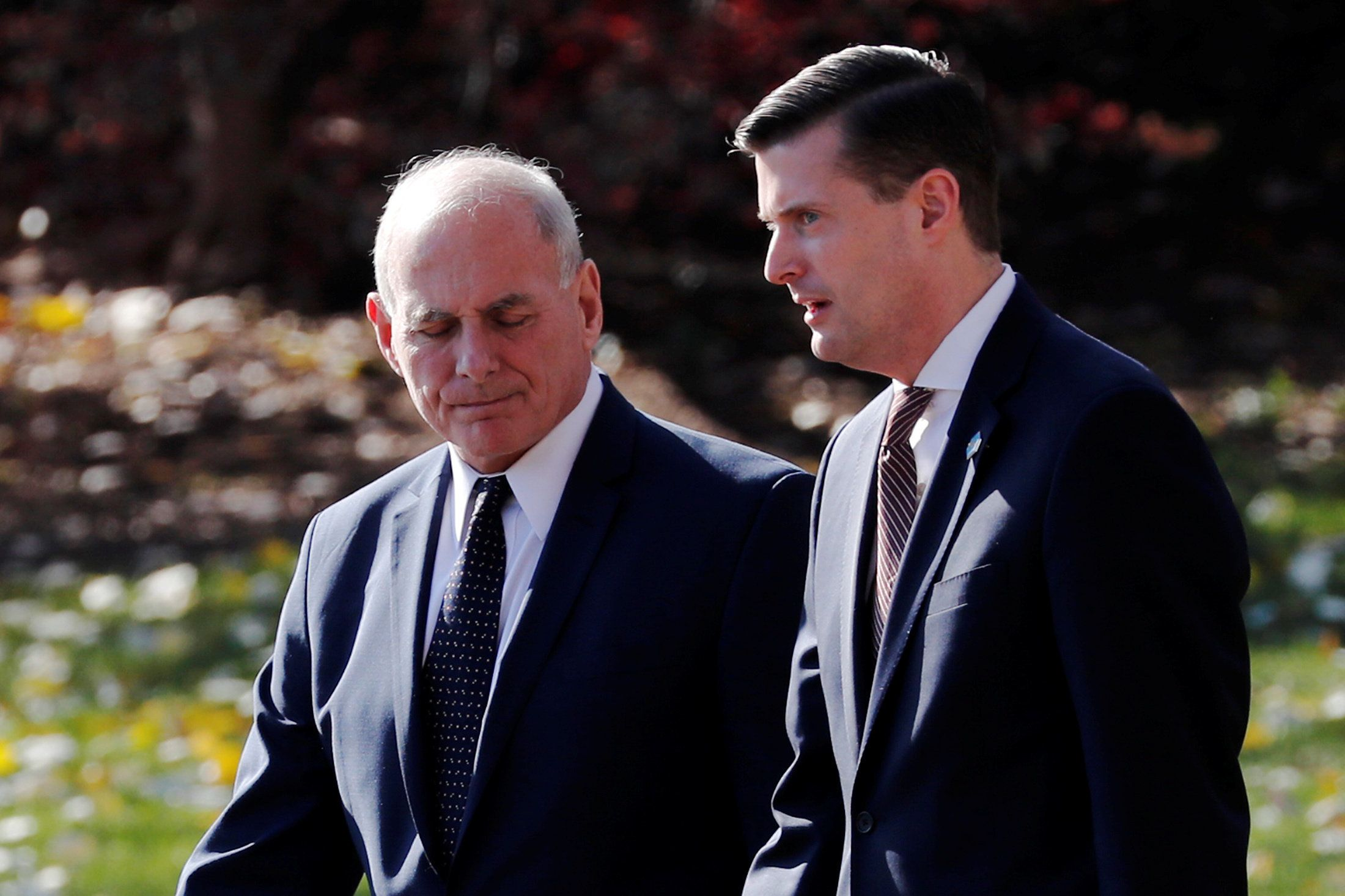 White House chief of staff John Kelly walks with White House staff secretary Rob Porter on Nov. 29,