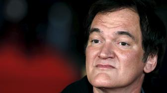 """Director Quentin Tarantino poses as he arrives for the European premiere of """"The Hateful Eight"""" at Leicester Square in London, Britain, December 10, 2015. REUTERS/Luke MacGregor"""