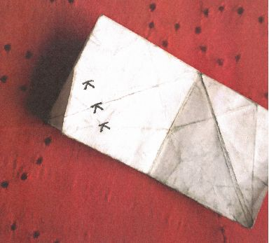 "A photo of ""KKK origami"" allegedly given to a black student at a Texas school."