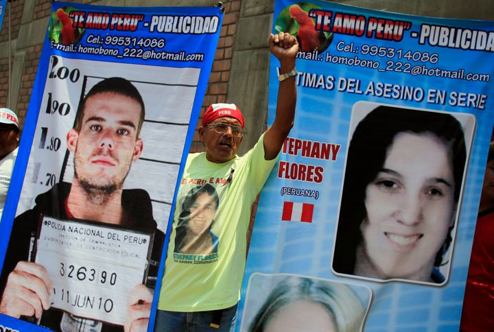 A man in Lima, Peru, holds posters of Dutch citizen Joran Van der Sloot and Peruvian girl Stephany Flores outside the Lurigan