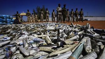 Members of Rapid Support Forces (RSF), Sudans controversial counter-insurgency unit, show on November 5, 2017 in Khartoum sacks of hashish that were captured in the state of South Darfur a week earlier. About 19 tonnes of hashish was seized after an RSF unit ambushed a gang of smugglers that was transporting the drugs to Khartoum.  / AFP PHOTO / ASHRAF SHAZLY        (Photo credit should read ASHRAF SHAZLY/AFP/Getty Images)