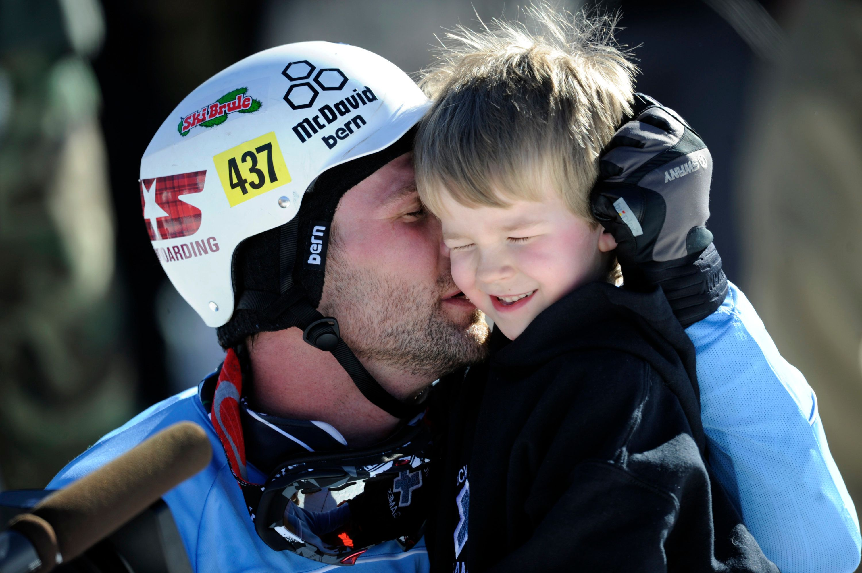 Nick Baumgartner hugs his son, Landon, 6, following his gold medal run in the men's Snowboarder X finals at the Winter X Games on Buttermilk Mountain on Saturday, January 29, 2011. Baumgartner's win was his first X Games medal and it ended Nate Holland's streak of five consecutive gold's in the event. AAron Ontiveroz, The Denver Post  (Photo By AAron Ontiveroz/The Denver Post via Getty Images)