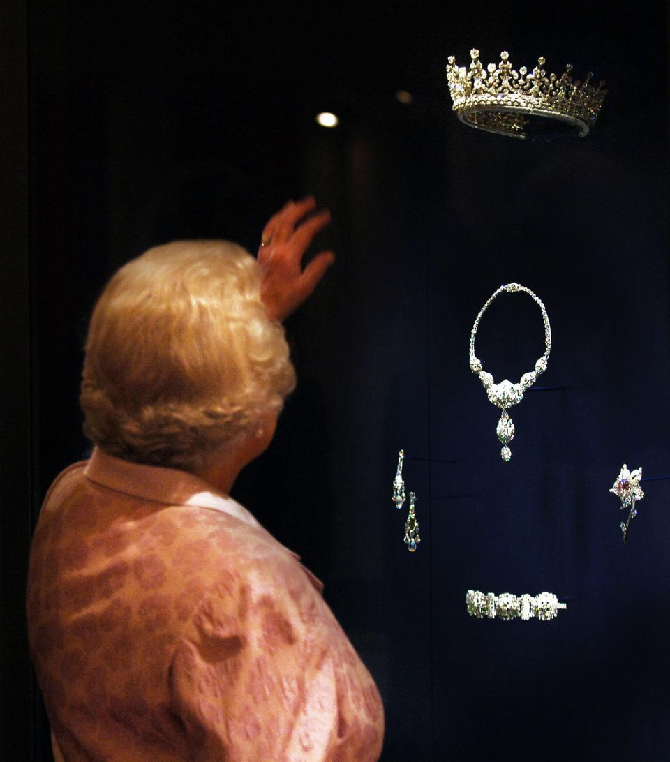 Queen Elizabeth II shown in 2007 looking at the Queen Mary Diamond Tiara given to her as a wedding present by her grandmother Queen Mary, who herself received it as a wedding gift