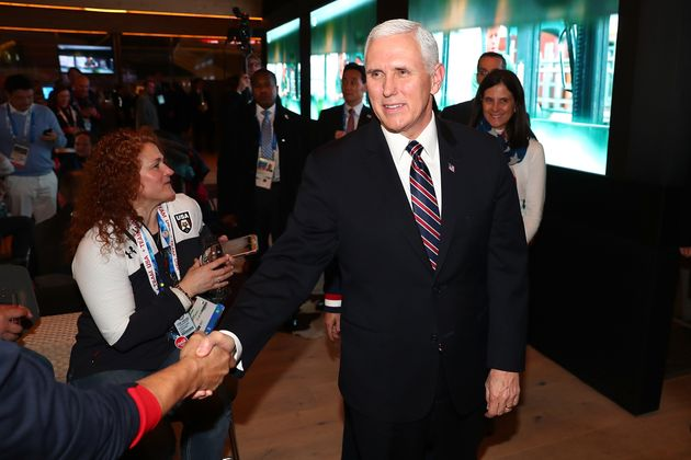 Mike Pence visits with guests at the USA House at the Winter