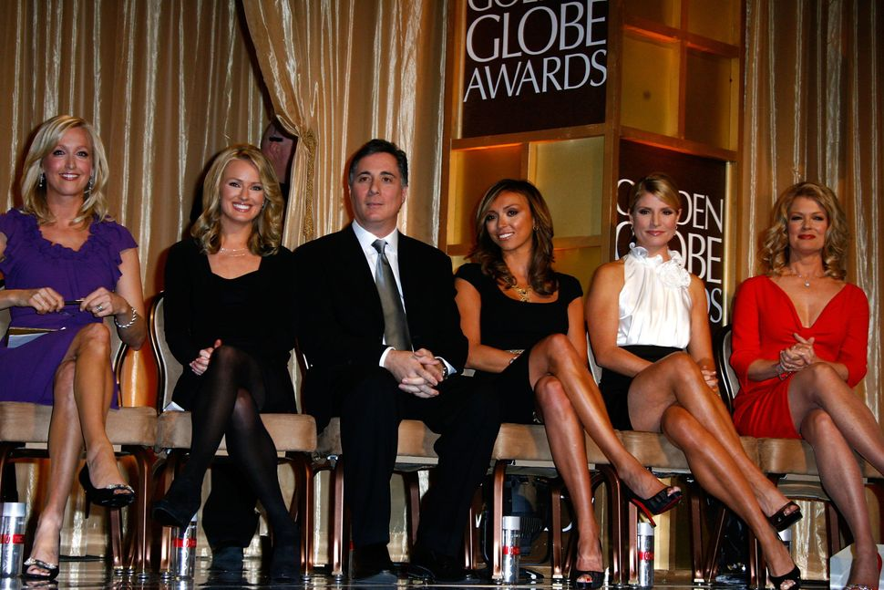 Entertainment news anchors Lara Spencer, Brooke Anderson, Jim Moret, Giuliana Rancic, Dayna Devon and Mary Hart at The 65th A